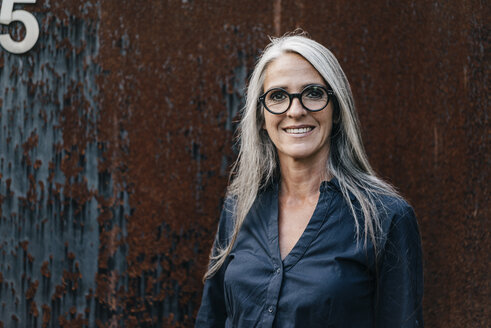 Portrait of smiling woman with long grey hair - KNSF00498