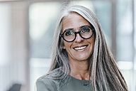Portrait of smiling woman with long grey hair - KNSF00543