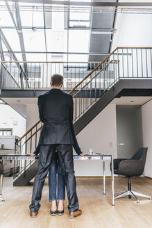 Businessman close to businesswoman in office - KNSF00564