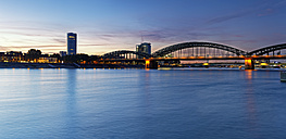 Germany, Cologne, view to KoelnTriangle and Hohenzollern Bridge at evening twilight - GFF00875
