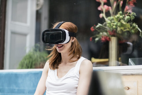 Redheaded woman wearing Virtual Reality Glasses - TAMF00777