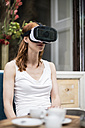 Redheaded woman wearing Virtual Reality Glasses - TAMF00780