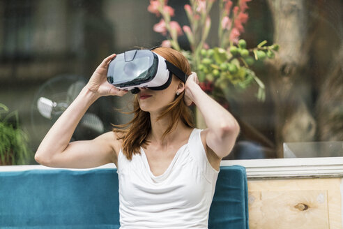 Redheaded woman wearing Virtual Reality Glasses - TAMF00783