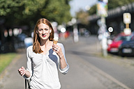 Portrait of smiling woman eating icecream - TAMF00798