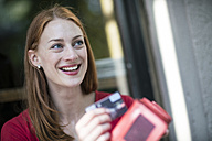 Portrait of smiling woman with purse and credit card - TAMF00807