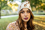 Portrait of young woman wearing wooly hat - MGOF02607