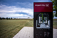 Germany, Berlin Brandenburg Airport, information board and meadow - BIG00056