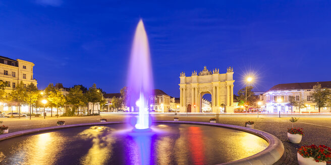 Germany, Potsdam, view to Brandenburg Gate with fountain in the foreground at night - WDF03773