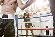 Woman watching boxing match - MADF01245