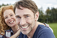 Portrait of smiling couple outdoors - FMKF03209