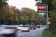 Germany, Stuttgart, Warning sign for particulate pollution on highway - WDF03791