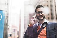 USA, New York City, Businessman using smart phone - UUF09236
