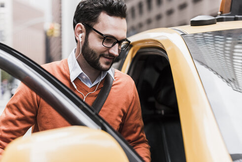 USA, New York City, Businessman entering cab - UUF09242