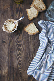Parmesan, slices of white bread, cloth and fork on dark wood - DAIF00007
