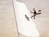 Young man skate boarding in skate park - LAF01810