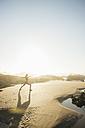 Portugal, Alentejo, Woman practicing yoga at Zambujeira do Mar beach - CHPF00337