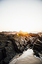 Portugal, Alentejo, Sunset at Zambujeira do Mar beach - CHPF00340