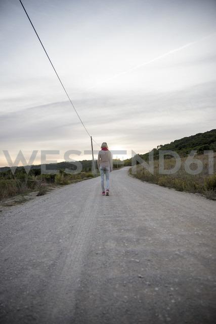 Portugal, Woman walking away, rear view - CHPF00346
