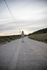 Portugal, Woman walking away, rear view - CHPF00346