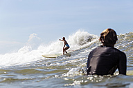 Indonesia, Bali, woman surfing - KNTF00581