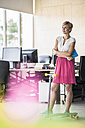 Woman standing in creative office - RIBF00631