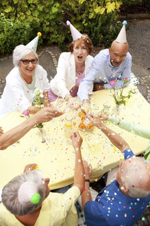 Group of seniors celebrating, drinking champagne - MFRF00782