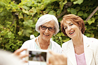 Man taking selfie of two senior women - MFRF00824