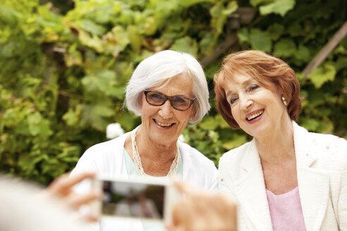 Man taking selfie of two senior women - MFRF00824
