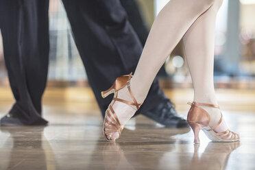 Feet of dancing couple in studio - ZEF11740