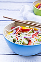 Bowl of glass noodle salad with vegetables on wood - LVF05617