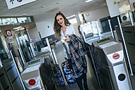 Woman coming out of train station - KIJF00897