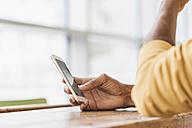 Young man using smart phone, close up - JOSF00386