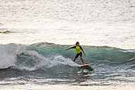 Boy surfing in the sea - SIPF01106