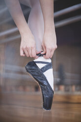 Ballet dancer putting shoes on - ZEF11763