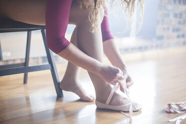 Ballet dancer putting shoes on - ZEF11781