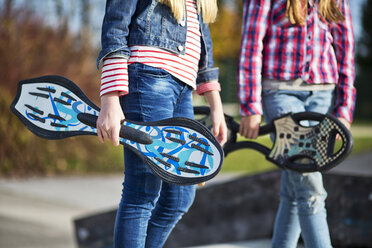 Two girls with skateboards, partial view - MAEF12055