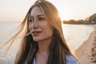 Portrait of young woman on the at sunset - KNSF00702