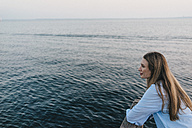 Young woman in front of the sea - KNSF00705