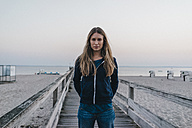 Portrait of young woman standing on jetty - KNSF00708