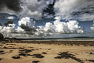 France, Lancieux, sandy beach on cloudy day - FMKF03259