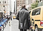 USA, New York City, businessman on the move in Manhattan - UUF09323