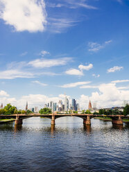 Germany, Frankfurt, view to skyline  with Ignatz-Bubis-Bridge and Main River in the foreground - KRPF02045