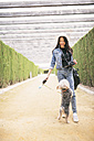 Young woman going walkies with her dog - JASF01304