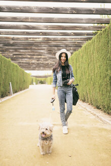 Young woman going walkies with her dog - JASF01307