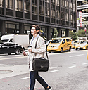 USA, New York City, woman in Manhattan on the go - UUF09411