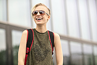 Portrait of laughing blonde woman wearing sunglasses - TAMF00856