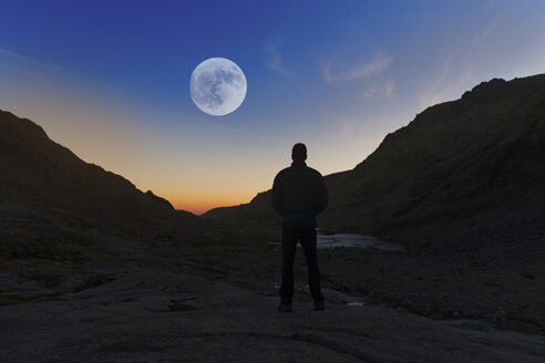 Spain, Sierra de Gredos, silhouette of man looking at the full moon - ERLF00199