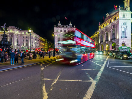 UK, London, Piccadilly Circus, driving double-decker bus at night - AM05094