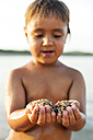 Little boy's hands holding sand, close-up - VABF00851