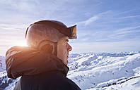 Austria, Greater Walser Valley, Damuls, Snowboarder in the mountains - FMKF03270
